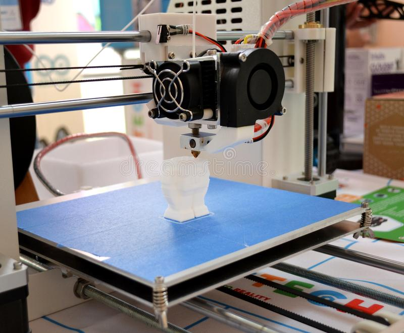 The process of working 3D printer and creating a three-dimensional object stock photography