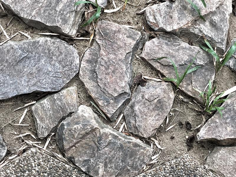 Imperfection of rocks pavement royalty free stock photo