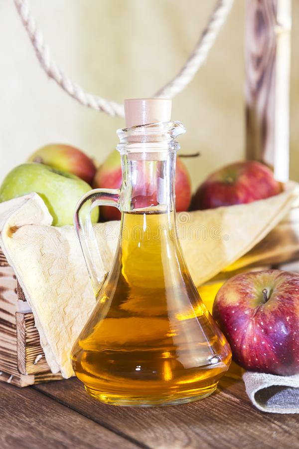 Processing of an agricultural crop of red and green apples. Home canning, healthy diet vegetarian food. Spiced apple cider vinegar royalty free stock photography