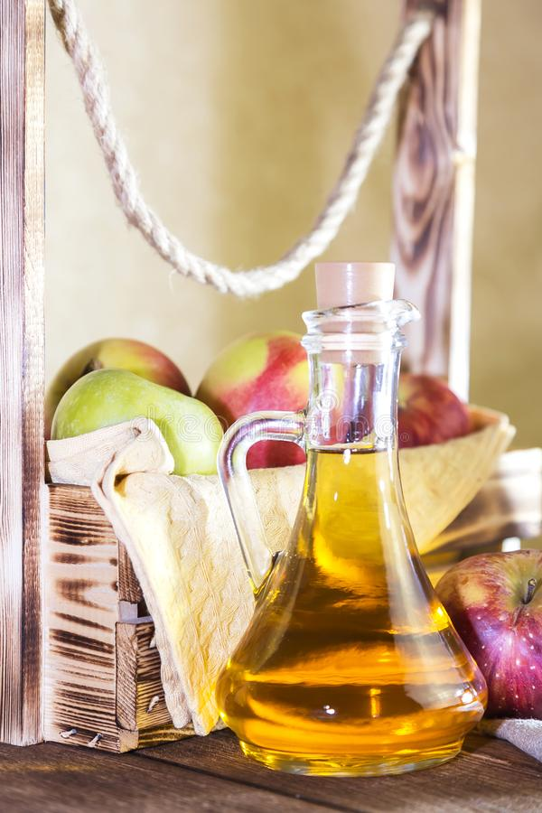 Processing of an agricultural crop of red and green apples. Home canning, healthy diet vegetarian food. Spiced apple cider vinegar stock photos