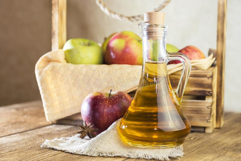 Processing of an agricultural crop of red and green apples. Homemade preparations, healthy diet vegetarian food. Spiced apple stock photos