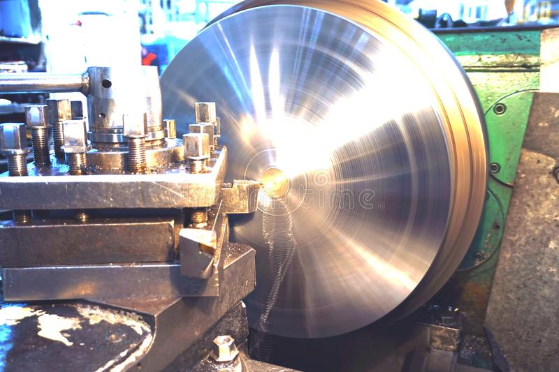 Processing of metal by cutting, final processing of parts on a lathe. royalty free stock photos