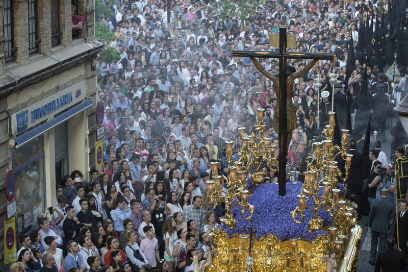 Procession of a Christ in Easter in Seville stock photos