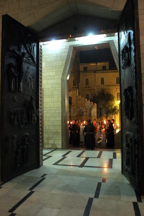 Procession goes through the streets of Nazareth. Every Friday procession goes through the streets of Nazareth, from the Church of St. Joseph to the Basilica of stock photo