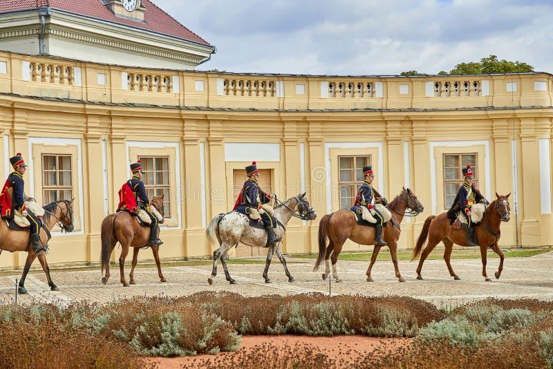 Procession of horsemen in historical uniform from Napoleon Bonaparte period in great court of Slavkov-Austerlitz castle royalty free stock photography