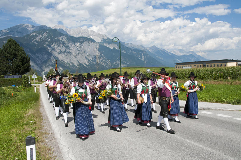 Procession of Maria Ascension in Axams Austria. AXAMS,AUSTRIA - AUGUST 15:Unidentified people walking in procession to the church on Maria Ascension,on August 15 stock image