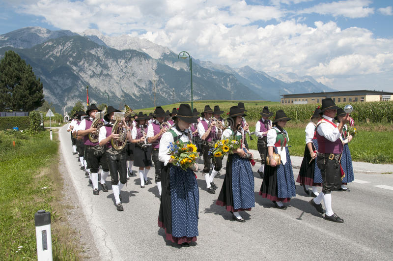 Procession of Maria Ascension in Axams Austria. People walking in procession to the church on Maria Ascension in Axams royalty free stock photo