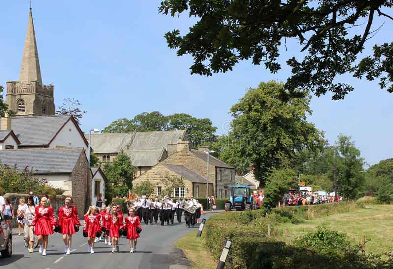 Procession, people and floats village fete day. View along School Lane in Pilling, Lancashire, England on Coffee Feast (annual village fete) with various groups stock photo