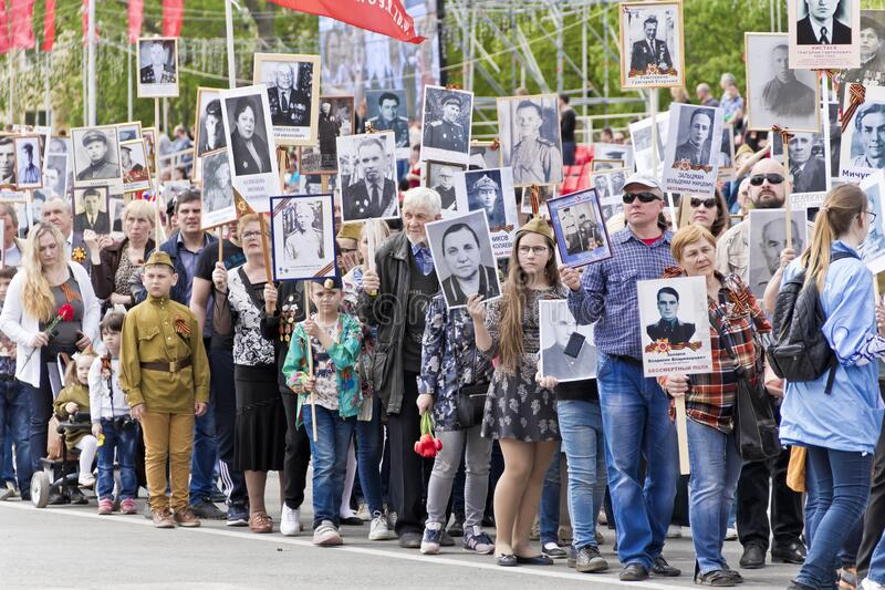 Procession of the people in Immortal Regiment on annual Victory Day stock photo