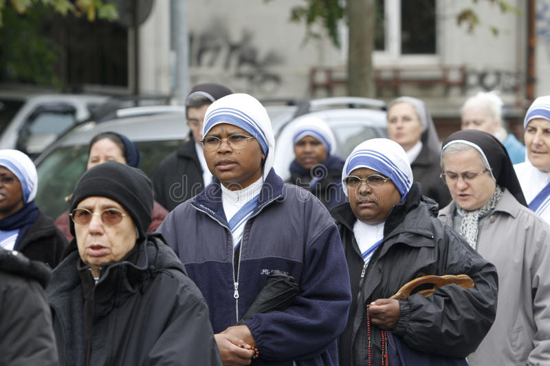 Procession with the relic of Saint Pope John Paul II. BUCHAREST, ROMANIA - OCTOBER 23, 2016: Catholic nuns are praying during the Eucharistic procession with the stock photography