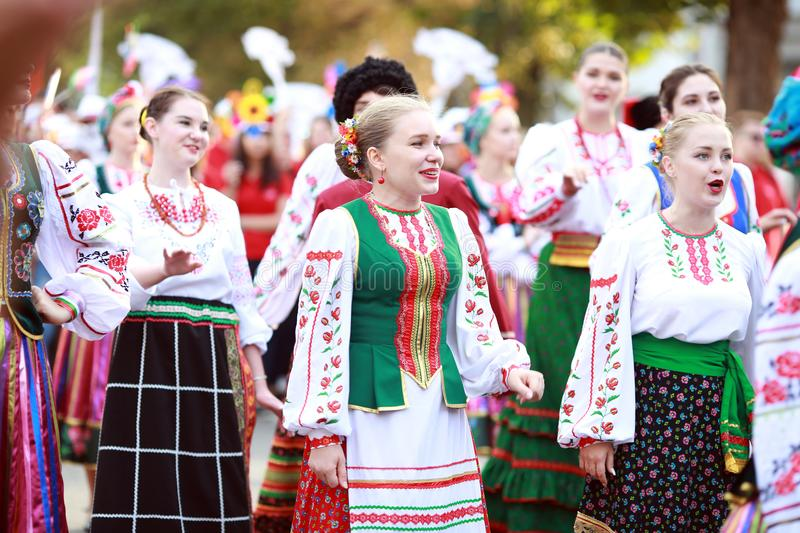 Procession of students of the Institute of culture, dancers in Cossack traditional dress, colored skirt, green trousers and maroon stock photography