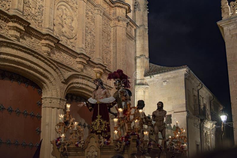 Processions through the streets of Salamanca , Spain. Salamanca, Spain; March 2017: Procession of the Hermandad de Penitencia de Nuestro Padre Jesús Despojado stock images