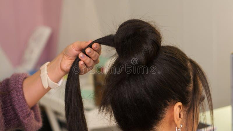 Processo della creazione dei capelli fotografia stock