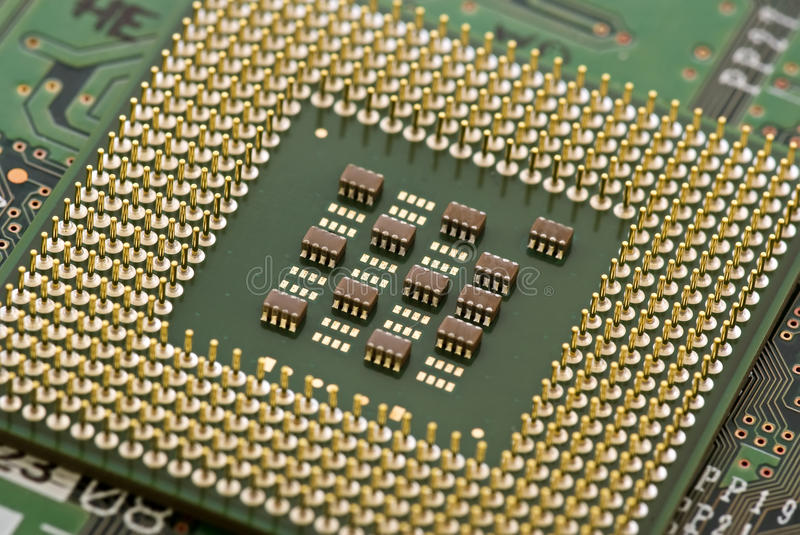 Processor. With connectors and chips as closeup on a circuit board stock photography