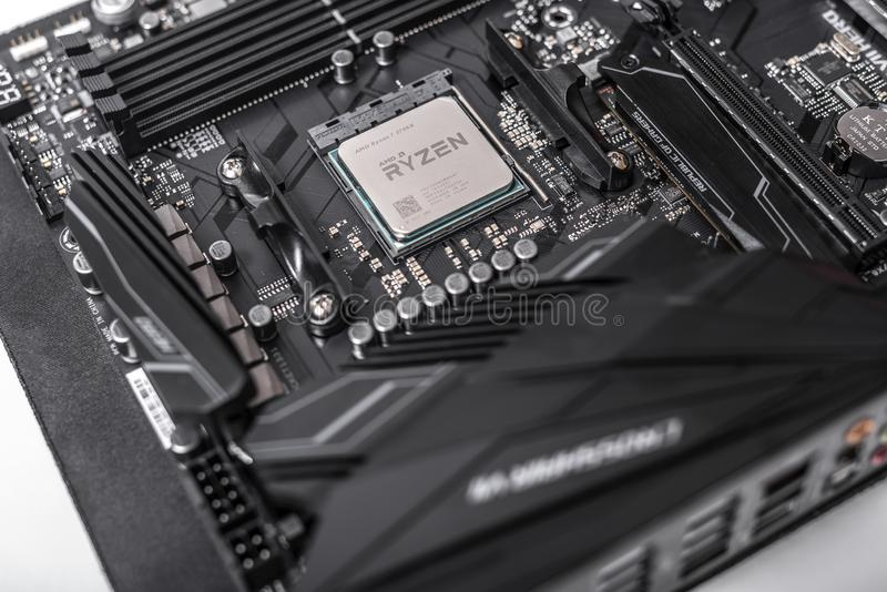 Processor Ryzen 7 2700X against the background of a computer motherboard Asus rog crosshair vii hero. stock images