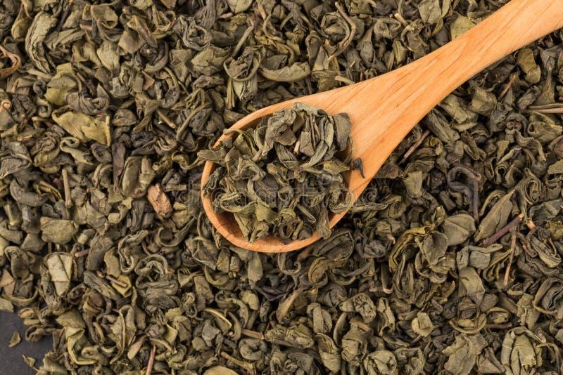 Download Proch zielona herbata zdjęcie stock. Obraz złożonej z wysuszony - 106917626