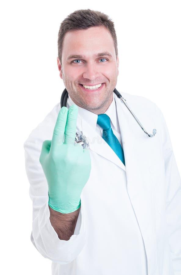 Proctologo maschio sorridente pronto per l'esame delle dita fotografie stock