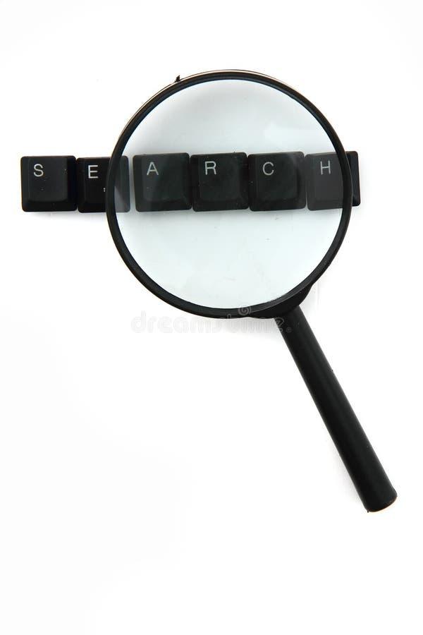 Procurare (chaves de teclado) e amplie o vidro imagem de stock