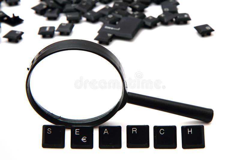 Procurare (chaves de teclado) e amplie o vidro imagens de stock royalty free