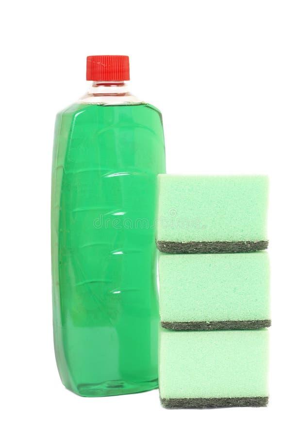 Prodotti di pulizia su bianco immagine stock