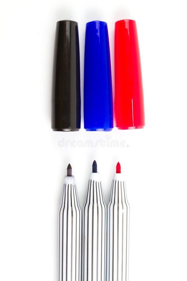 Prodotto chimico a tre colori o penna di indicatori immagini stock libere da diritti