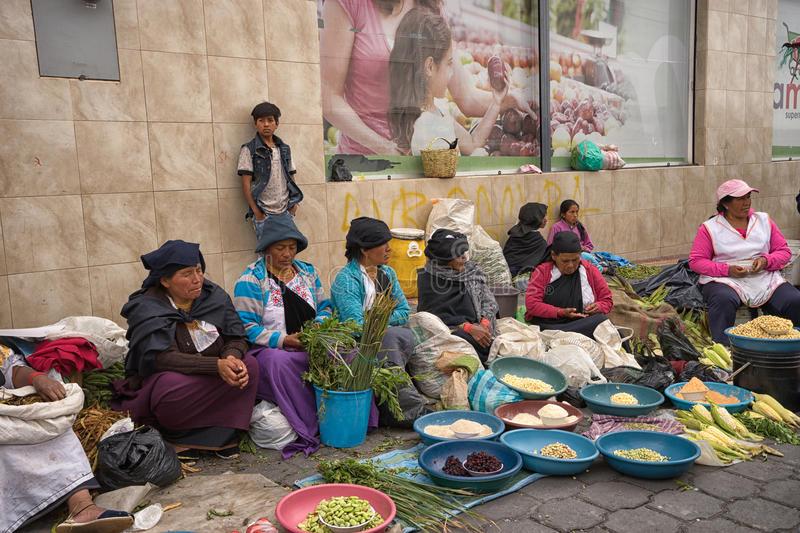 Produce vendors in the Saturday market in Otavalo stock photos