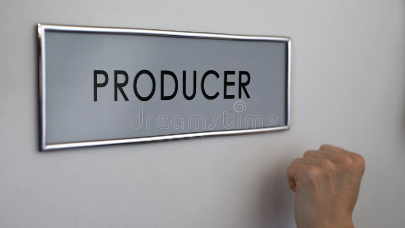 Producer office door, hand knocking closeup, television and radio broadcasting stock photo