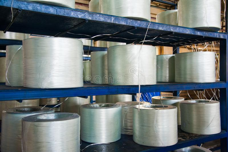 Producing fiberglass rods - manufacture of composite reinforcement. Industry for construction stock photos