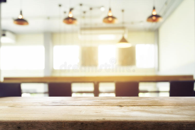Product display template. Business presentation. Empty wood table or floor with blur coworker place coffee cafe shop restaurant bokeh background. Product royalty free stock image