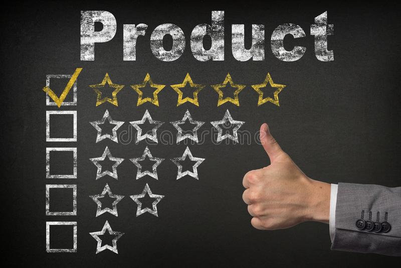 Product five 5 star rating. thumbs up service golden rating stars on chalkboard.  royalty free stock photos