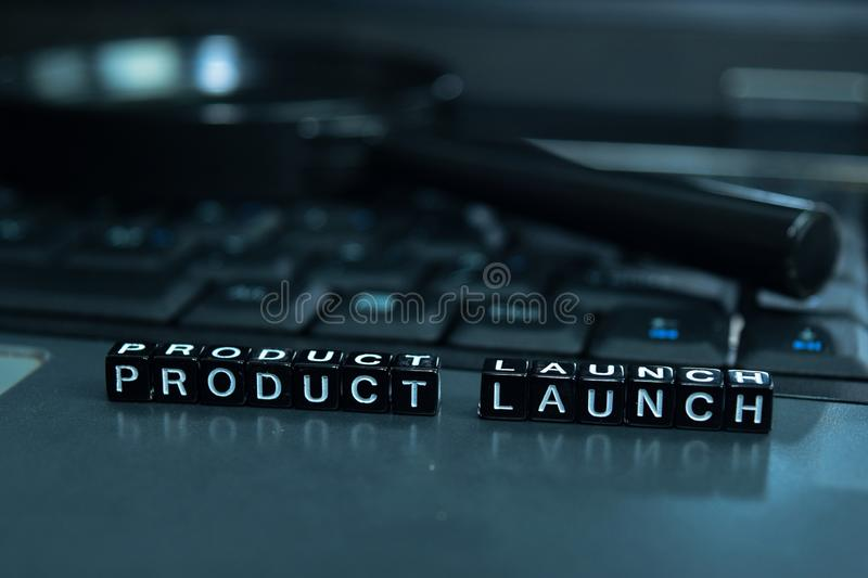 Product Launch text wooden blocks in laptop background. Business and technology concept royalty free stock photo