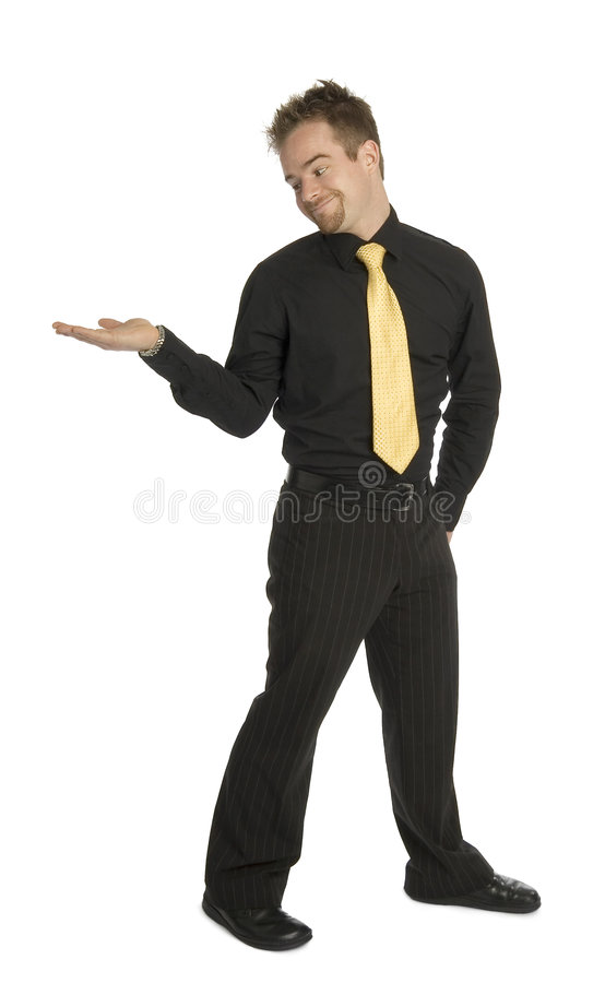 Product placement. Well dressed man standing looking at empty outstretched hand. ready for product placement royalty free stock photography