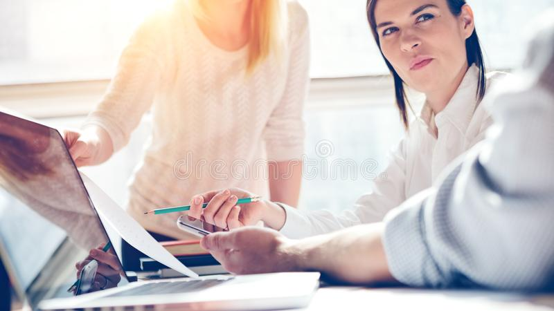 Product presentation. Marketing team at work. Open space loft office. Laptop and paperwork stock images