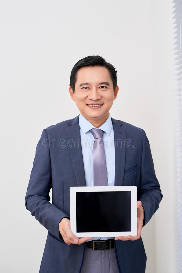 Product presentation. Promotion. Business man holding in hands tablet computer with blank screen, close up.  royalty free stock image