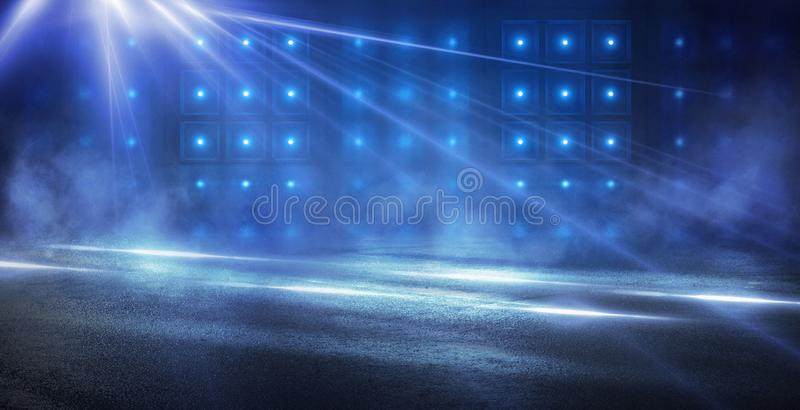 Abstract blue background with rays of neon light, spotlight, reflection on the asphalt. stock images
