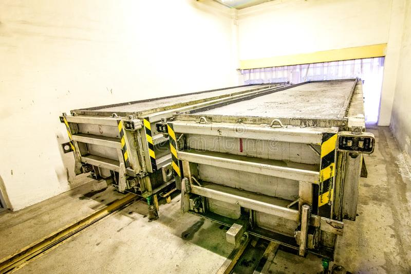 Production of aerated concrete blocks in metal box at factory. Production of aerated concrete blocks in metal box at bright new factory stock photo