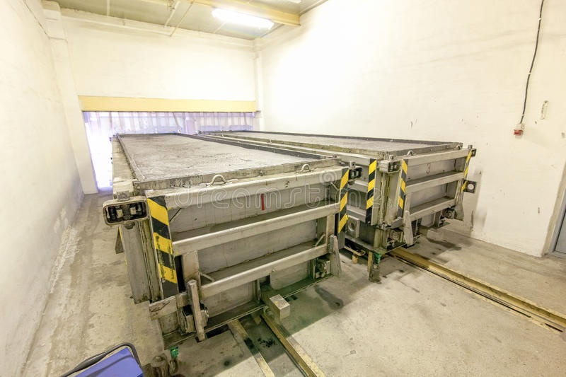 Production of aerated concrete blocks in metal box at factory. Production of aerated concrete blocks in metal box at bright new factory stock photography