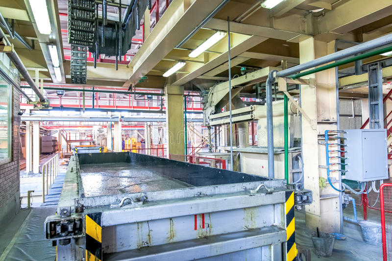 Production of aerated concrete blocks in metal box at factory. Production of aerated concrete blocks in metal box at bright new factory royalty free stock photos