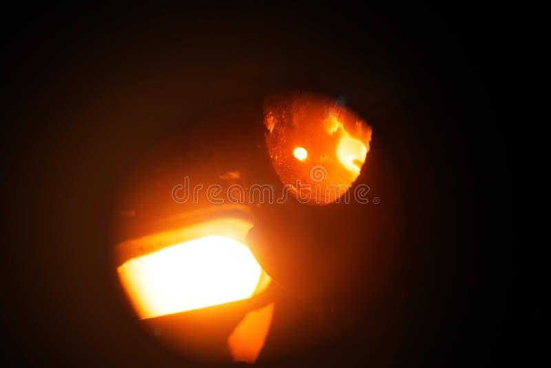 Production of aluminium. Melting furnace on a black background. Aluminium foundry. Orange bright molten steel. stock image