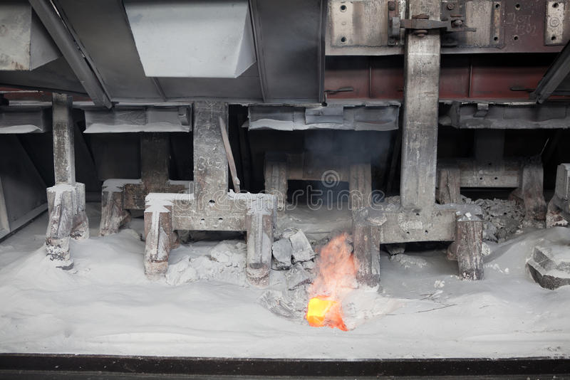 Production of aluminum by electrolysis. Electrochemical, electrolytic process of production of aluminium on factory. Flame from electrolysis bath stock photography