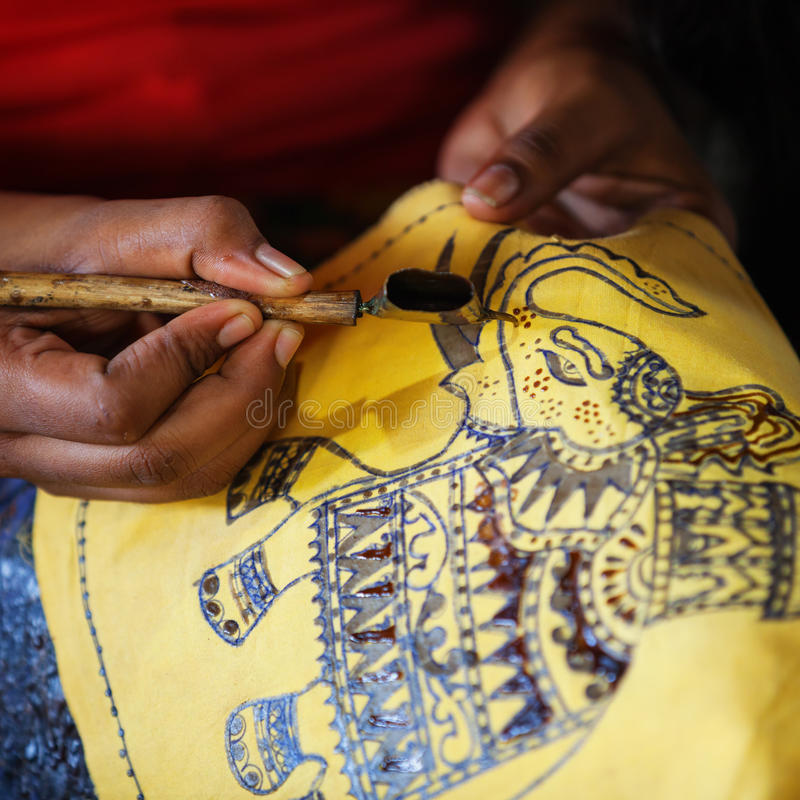 Production of batik - Spouted tool - canting. Tjanting. ANURANHAPURA, SRI LANKA - CIRCA APR 2013: production of batik - Spouted tool - canting. Tjanting royalty free stock images