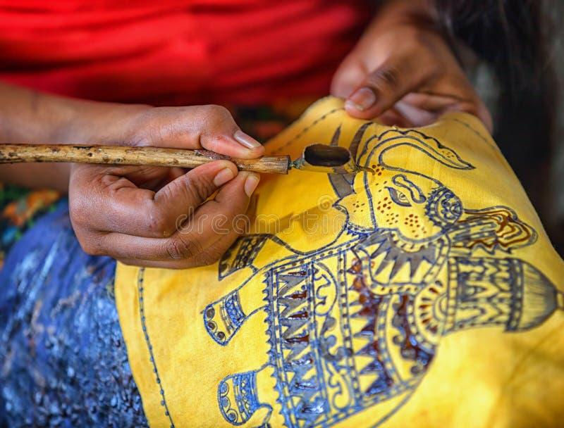 Production of batik - Spouted tool - canting. Tjanting. ANURANHAPURA, SRI LANKA - CIRCA APR 2013: production of batik - Spouted tool - canting. Tjanting stock photography