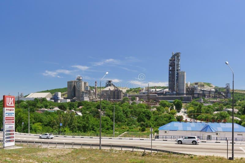 Production buildings of the city-forming enterprise Verkhnebakansky cement plant. Technogenic landscape royalty free stock photos