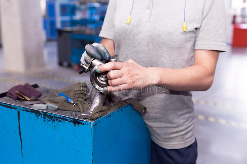 Manual work in production of vehicle part in the automotive industry. Production of car parts in the automotive industry royalty free stock image