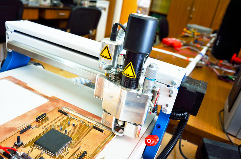 PCB Manufacturing With Industrial Tool Head Stock Photo - Image of ...