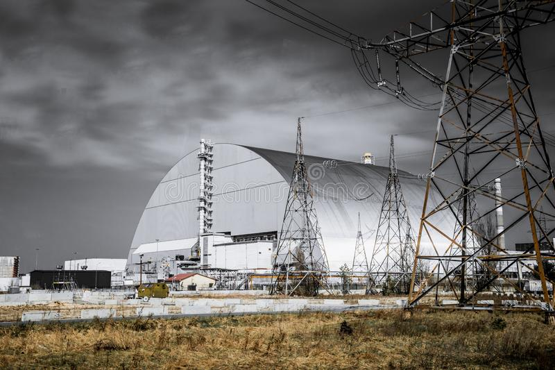 Production facilities of the Chernobyl nuclear power plant, Ukraine. Fourth emergency power unit and exclusion zone. Metal hangar protective shelter on the royalty free stock photography
