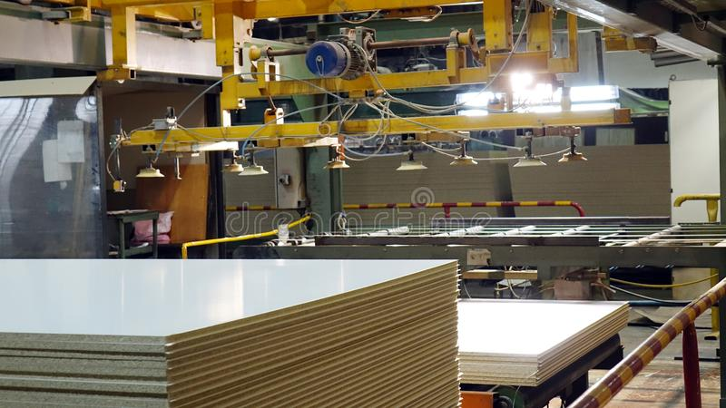 Production of laminated fiberboard. Fibreboard sheets for furniture production stock photos