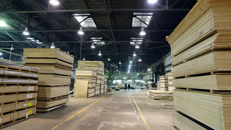 Production of laminated fiberboard. Fibreboard sheets for furniture production royalty free stock photography