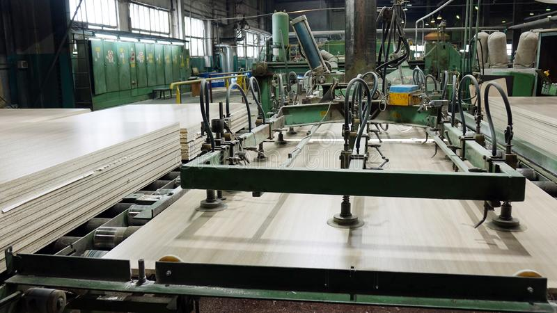 Production of laminated fiberboard. Fibreboard sheets for furniture production royalty free stock image