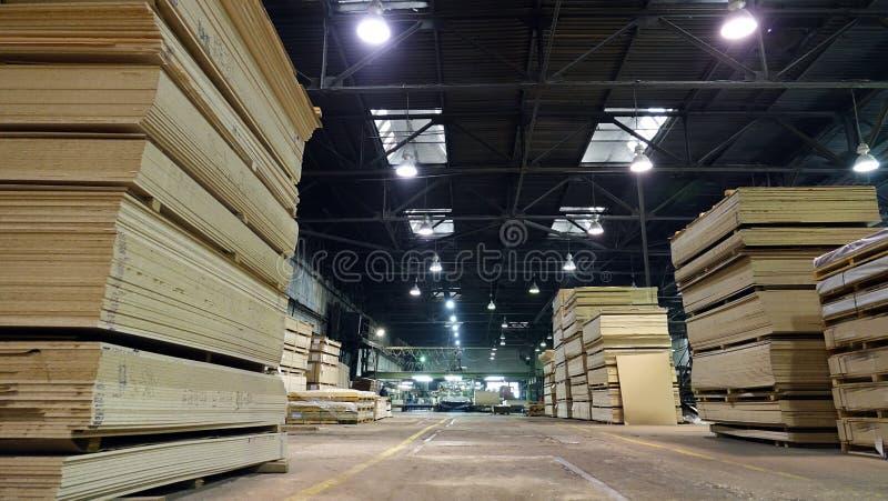 Production of laminated fiberboard. Fibreboard sheets for furniture production stock photo